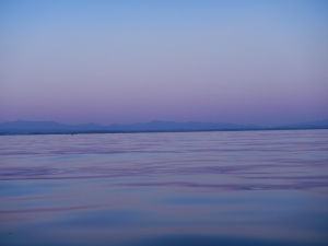 The purple hue of an early evening Lake Champlain.
