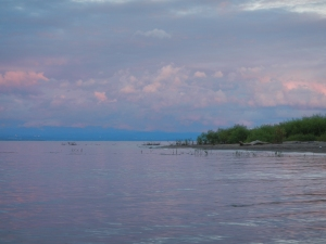 The purple hues of sunset reflecting back on the clouds over Lake Champlain.