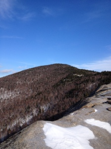 Looking up to the summit of Pitchoff Mountain from the Balanced Boulders