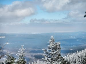 A distant view of a frozen Lake Champlain.